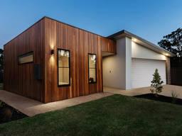 Prefabricated frame-panel house kit